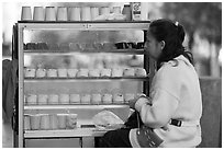 Woman selling dairy desserts on the street. Guadalajara, Jalisco, Mexico (black and white)