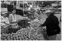 Fruit vending in Mercado Libertad. Guadalajara, Jalisco, Mexico (black and white)