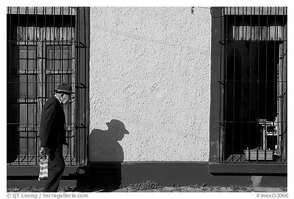Elderly man walking along a colorful wall, Tlaquepaque. Jalisco, Mexico