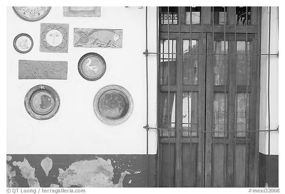 Wall decorated with colorful ceramic pieces, Tlaquepaque. Jalisco, Mexico (black and white)