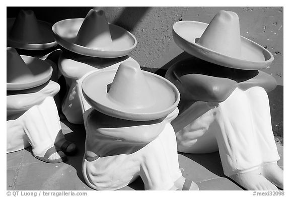 Ceramic statues of men with sombrero hats, Tlaquepaque. Jalisco, Mexico (black and white)