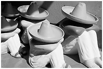 Ceramic statues of men with sombrero hats, Tlaquepaque. Jalisco, Mexico ( black and white)