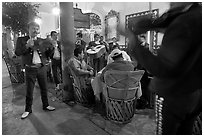 Mariachi musicians performing a serenade at the Parian, Tlaquepaque. Jalisco, Mexico ( black and white)