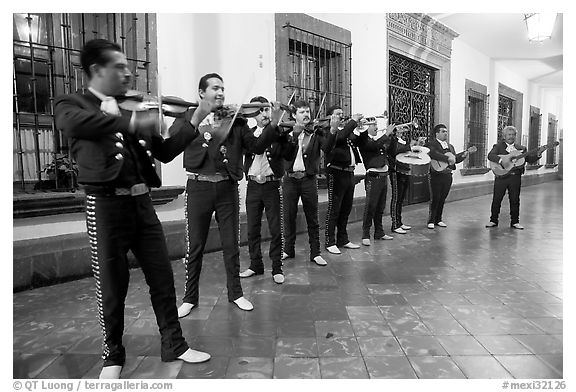 Black and white picture photo band of mariachi musicians at night tlaquepaque jalisco mexico