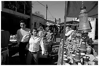 People strolling iin the sunday town-wide arts and crafts market, Tonala. Jalisco, Mexico (black and white)