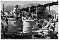 Pots being loaded on the back of a pick-up truck, Tonala. Jalisco, Mexico (black and white)