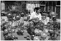Woman polishing glass spheres, Tonala. Jalisco, Mexico (black and white)