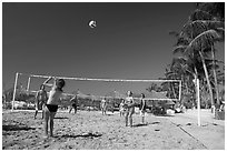 Vacationers playing beach volley-ball, Nuevo Vallarta, Nayarit. Jalisco, Mexico (black and white)