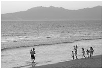 Family on the beach at sunset, Nuevo Vallarta, Nayarit. Jalisco, Mexico (black and white)