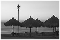 Shades and ocean at sunset, Nuevo Vallarta, Nayarit. Jalisco, Mexico (black and white)