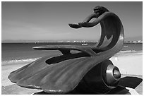 Sculpture by Bustamante on the seaside walkway with beach in the background, Puerto Vallarta, Jalisco. Jalisco, Mexico (black and white)
