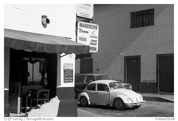 Restaurant at a street corner and Mexico made Wolskwagen bug, Puerto Vallarta, Jalisco. Jalisco, Mexico