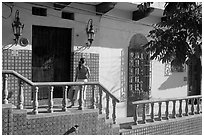 Woman waiting at the door of a house, Puerto Vallarta, Jalisco. Jalisco, Mexico (black and white)