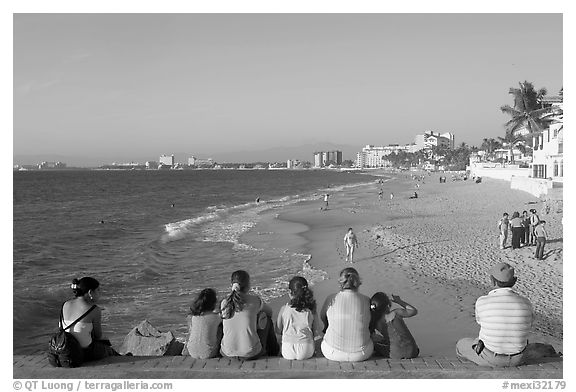 Black and white picture photo family sitting above the beach late afternoon puerto vallarta jalisco jalisco mexico