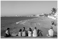 Family sitting above the beach, late afternoon, Puerto Vallarta, Jalisco. Jalisco, Mexico (black and white)