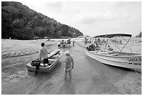 Boats moving from lagoon to ocean via small channel,  Boca de Tomatlan, Jalisco. Jalisco, Mexico ( black and white)