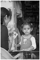 Girl playing with collages, Jalisco. Jalisco, Mexico (black and white)