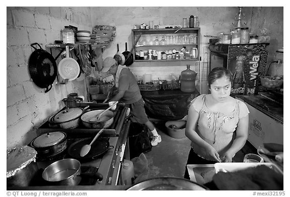 Woman and man in a restaurant kitchen, Jalisco. Jalisco, Mexico