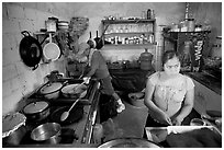 Woman and man in a restaurant kitchen, Jalisco. Jalisco, Mexico (black and white)