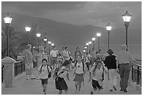 Children running on footbridge above Rio Cuale at dusk, Puerto Vallarta, Jalisco. Jalisco, Mexico (black and white)