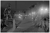 People strolling on the Malecon at night, Puerto Vallarta, Jalisco. Jalisco, Mexico (black and white)