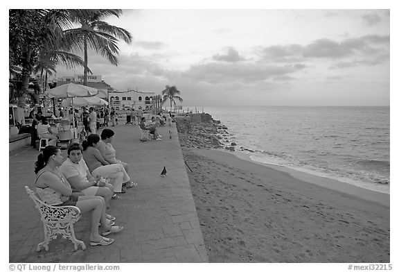 Women sitting on a bench looking at the ocean, Puerto Vallarta, Jalisco. Jalisco, Mexico (black and white)