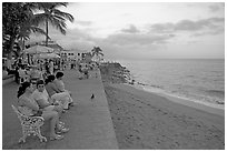 Women sitting on a bench looking at the ocean, Puerto Vallarta, Jalisco. Jalisco, Mexico ( black and white)