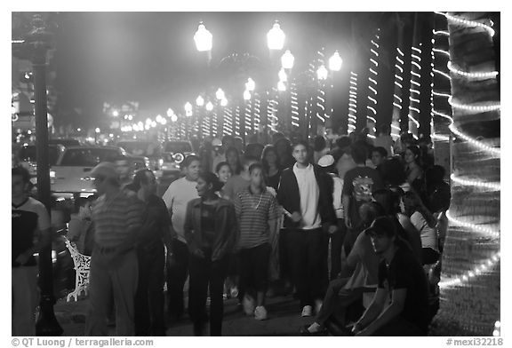 Crowds on the Malecon at night, Puerto Vallarta, Jalisco. Jalisco, Mexico (black and white)