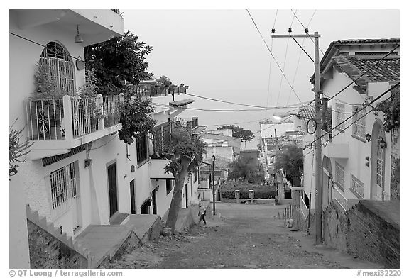 Steep street in morning foggy weather, Puerto Vallarta, Jalisco. Jalisco, Mexico (black and white)