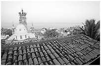 Tiled rooftop and Cathedral, and ocean at dawn, Puerto Vallarta, Jalisco. Jalisco, Mexico (black and white)