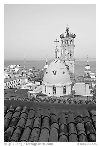 Red tile roof, Templo de Guadalupe Cathedral, and ocean early morning, Puerto Vallarta, Jalisco. Jalisco, Mexico (black and white)