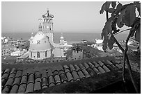 Red-tiled roof and Templo de Guadalupe Cathedral, early morning, Puerto Vallarta, Jalisco. Jalisco, Mexico (black and white)
