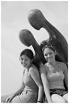 Women sitting on the sculpture called Nostalgia, Puerto Vallarta, Jalisco. Jalisco, Mexico ( black and white)