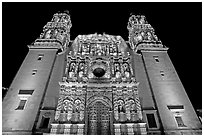 Illuminated facade of Cathdedral laced with Churrigueresque carvings at night. Zacatecas, Mexico (black and white)