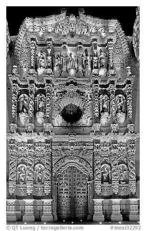 Illuminated churrigueresque carvings on the facade of the Cathdedral. Zacatecas, Mexico (black and white)