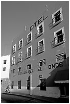 Hotel restaurant building painted bright blue and yellow. Guanajuato, Mexico (black and white)