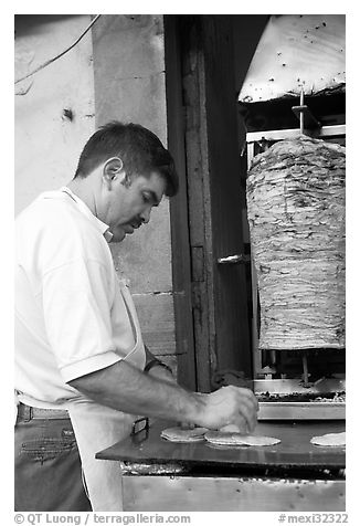 Man preparing tacos with meat. Guanajuato, Mexico (black and white)