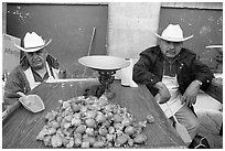 Men with cow-boy hats selling strawberries. Guanajuato, Mexico ( black and white)