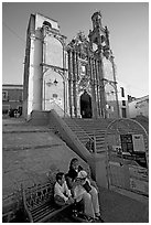 Woman and child waiting for bus below a church. Guanajuato, Mexico (black and white)
