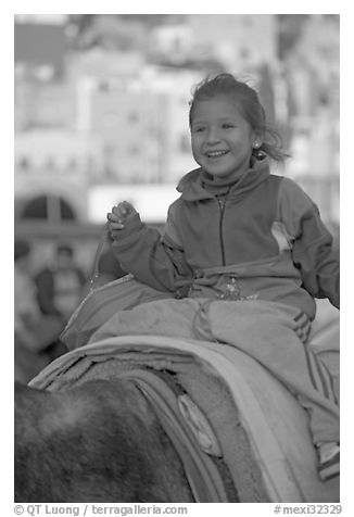 Girl riding a donkey. Guanajuato, Mexico (black and white)