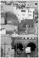 Houses on a hillside built above a tunnel. Guanajuato, Mexico (black and white)