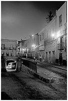 Juarez street and subterranean street with bus at night. Guanajuato, Mexico (black and white)