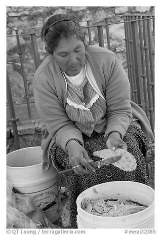 Woman peeling cactus. Guanajuato, Mexico (black and white)
