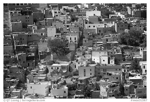 Brligly painted houses on hillside. Guanajuato, Mexico (black and white)