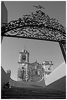 Forged metal gate and La Valenciana church. Guanajuato, Mexico (black and white)