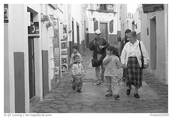 Family walking down an alley. Guanajuato, Mexico