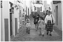 Family walking down an alley. Guanajuato, Mexico ( black and white)