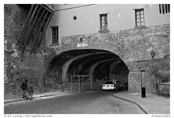 Entrance of one of the subterranean streets with a house built above. Guanajuato, Mexico (black and white)