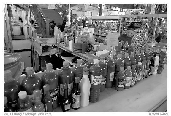 Chili bottles at a booth in Mercado Hidalgo. Guanajuato, Mexico (black and white)