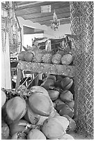 Tropical Fruit stand with girl in background. Mexico ( black and white)